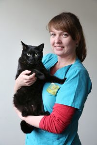 Wilson Vet Group Staff Member Smiling While Holding Black Cat
